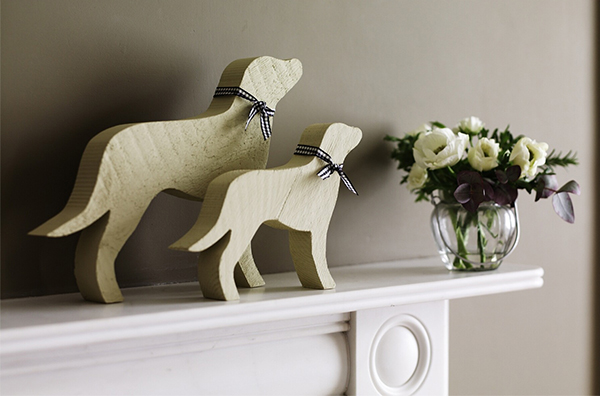 Dog ornaments on mantelpiece carved from reclaimed wood by Carol Ridler