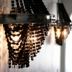 Upcycled bicycle chain wall lights