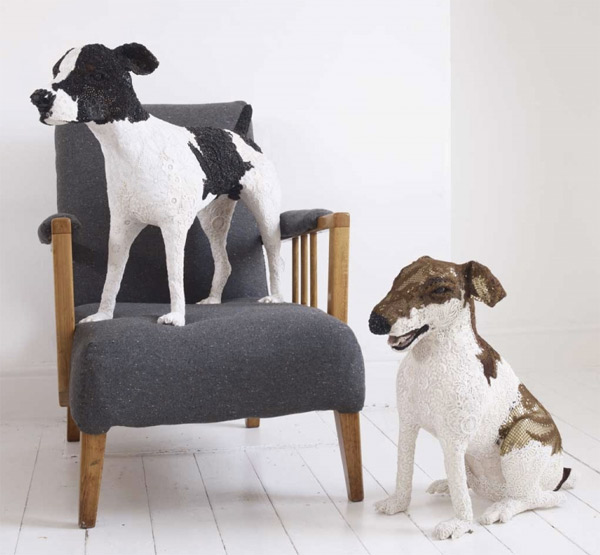 Dog sculptures made from vintage fabrics by Donya Coward with grey armchair