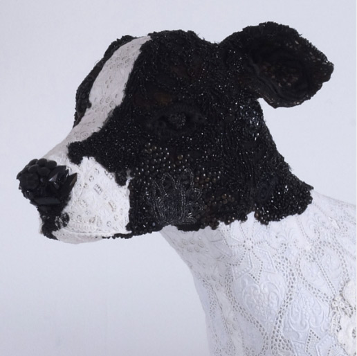 Detail of dog sculpture made from vintage fabrics and beadwork by Donya Coward