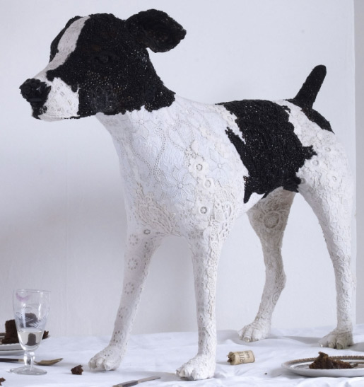 Black and white dog sculpture made from vintage lace by Donya Coward