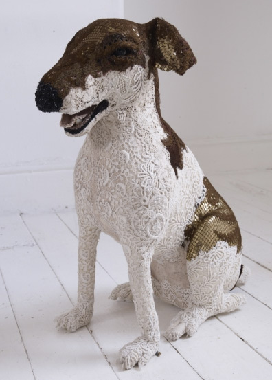 Brown and white sitting dog sculpture made from antique lace by Donya Coward