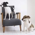 Two dog sculptures made from antique lace by textile artist Donya Coward