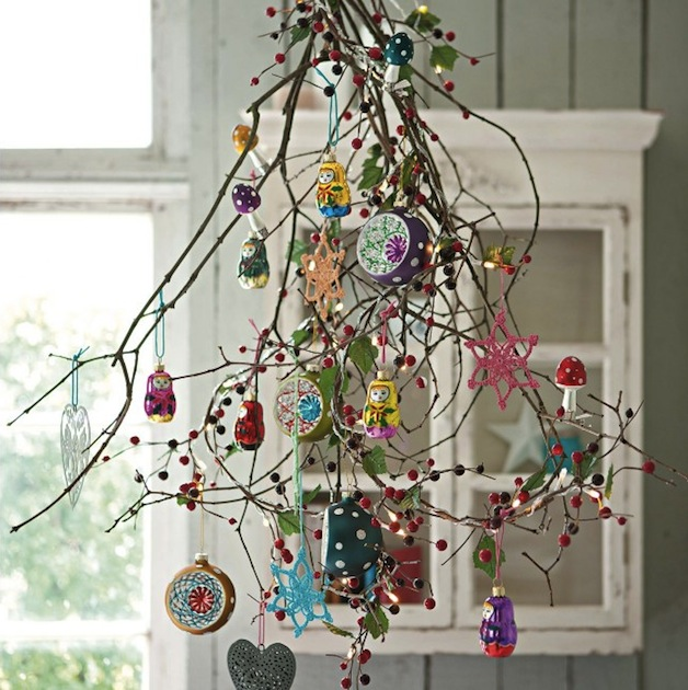 hanging branches in a kitchen decorated with berries and ornaments - Alternative Christmas Tree Decorations