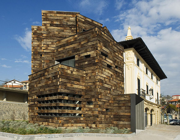 Reclaimed railway sleepers clad library extension - UPCYCLIST