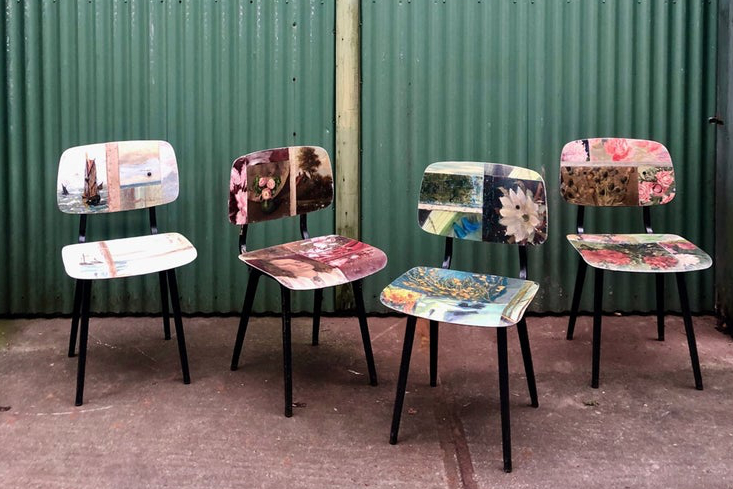 Chairs recovered with vintage paintings by artist Leslie Oschmann