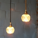 Upcycled crystal glass pendant lamps by Rafinesse and Tristesse