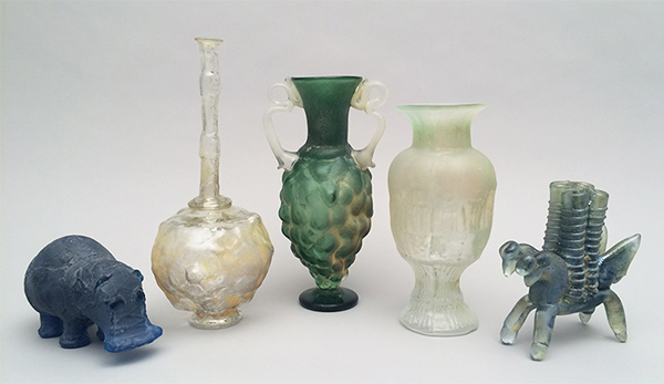 Group of glass vessels cast from plastic moulds by Shari Mendelson