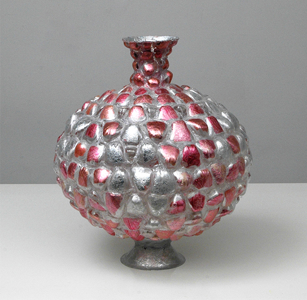 Pink and silver vessel made from plastic bottles by Shari Mendelson