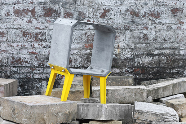Side table with yellow legs made from upcycled construction waste by Bentu