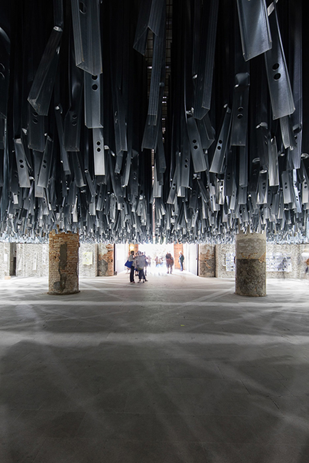 Detail of art installation created from hanging upcycled metal studs at Venice Architecture Biennale 2016 by Alejandro Aravena