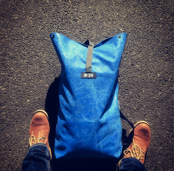 Blue backpack made from upcycled tarpaulin by M-24