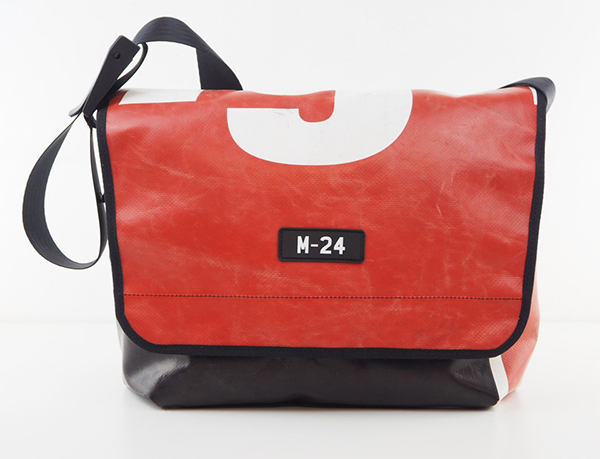Red and white messenger bag made from upcycled tarpaulin by m-24