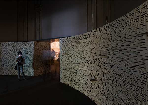 Walls lined with upcycled plaster board at Venice Architecture Biennale 2016 by architect Alejandro Aravena