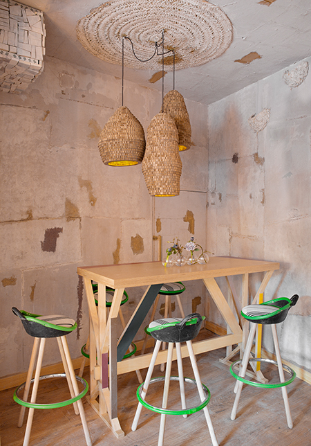 Green bar stools made from recycled materials in Mama Campo restaurant interior design