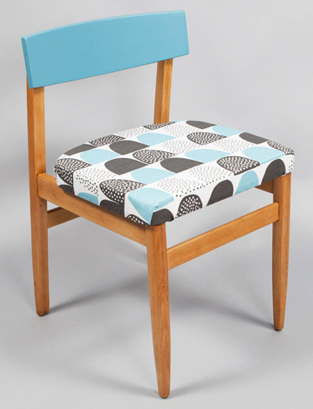 Vintage mid-century chair upholstered in blue patterned fabric