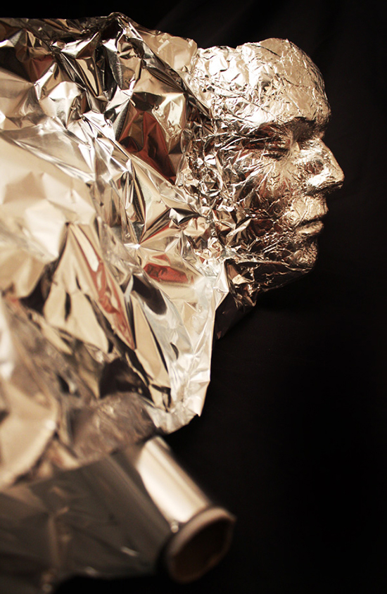 Face sculpture made from tin foil