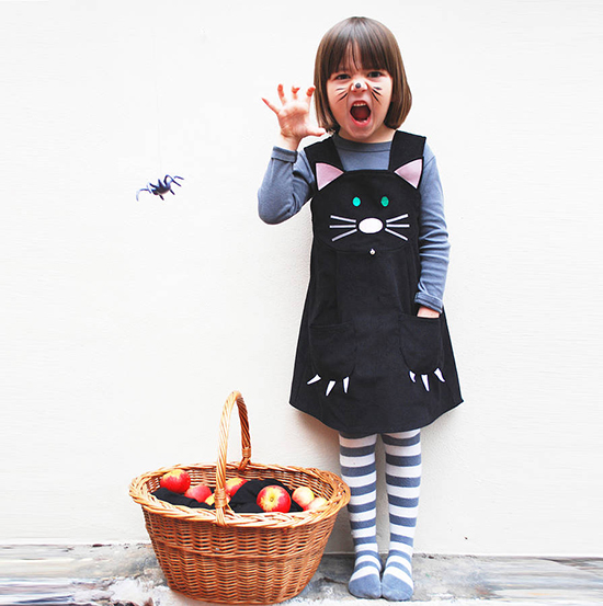 Girl wearing cat costume for Halloween