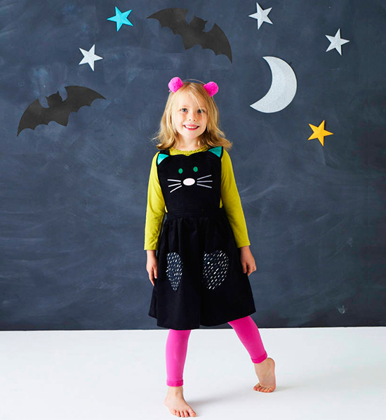 Girl wearing cat dress Halloween costume by Wild Things
