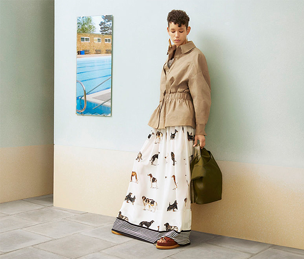 Model wearing dog print dress and jacket by Stella McCartney