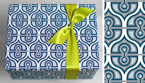 Gift wrapped in blue patterned gift wrap and green ribbon by Fishlips