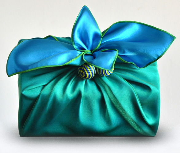 Gift wrapped in green and blue satin wrapping scarf
