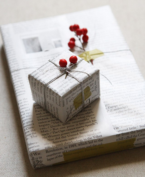 Gift wrapping paper made from magazine pages string and berries by Erin Boyle