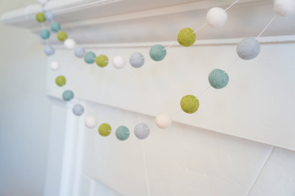 Green and white natural wool felted ball garland in white interior by SheepFuzzLA