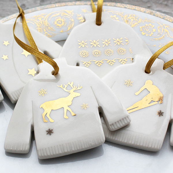 Porcelain decorations in the shape of Christmas jumpers by Etsy seller Jo Heckett