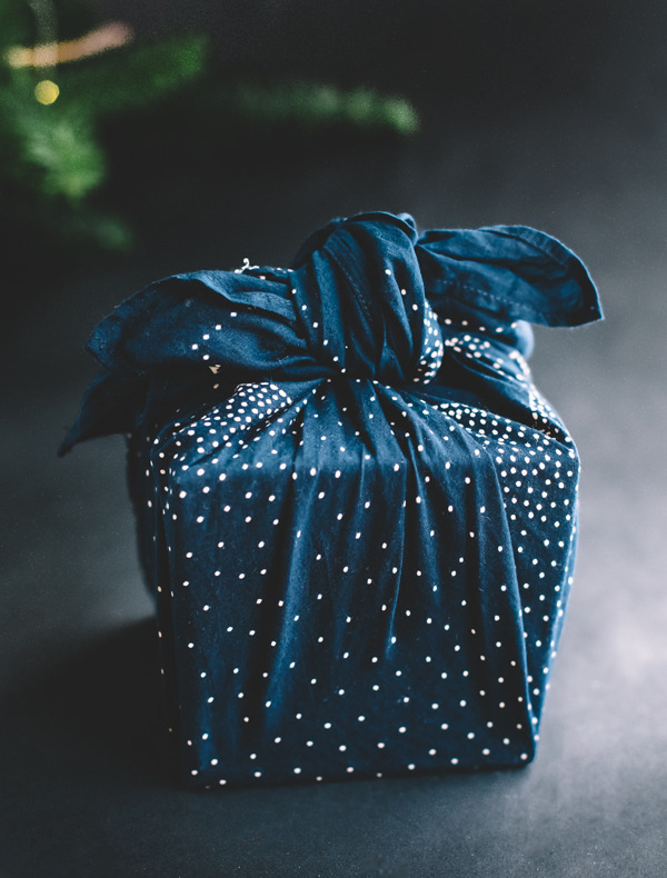 Present wrapped Furoshiki style in blue fabrici