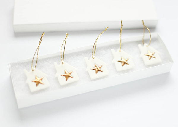 White porcelain hanging house ornaments with gold stars by DelphineandMax