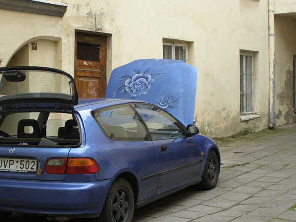 Car with bonnet embroidered with cross-stitch