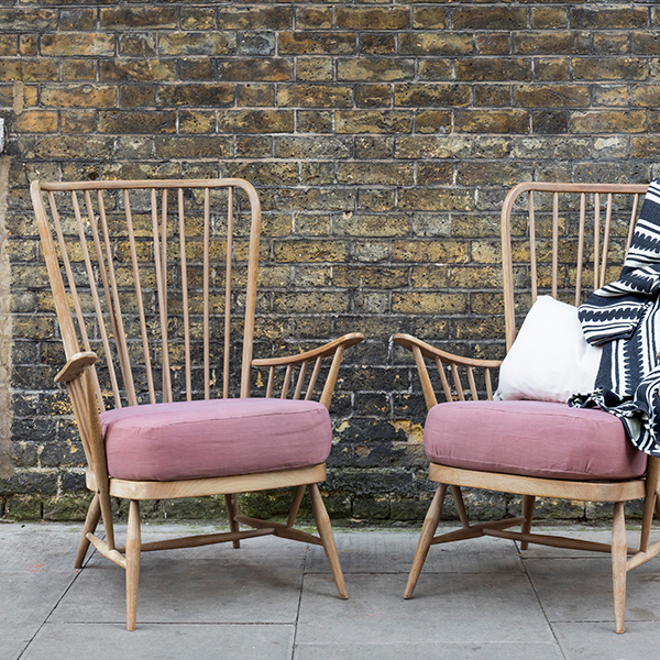 Ercol armchairs in front of brick wall