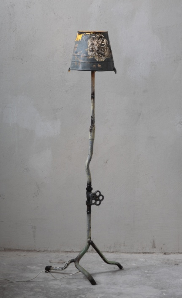 Floor light made from metal parts and cross-stitched bucket
