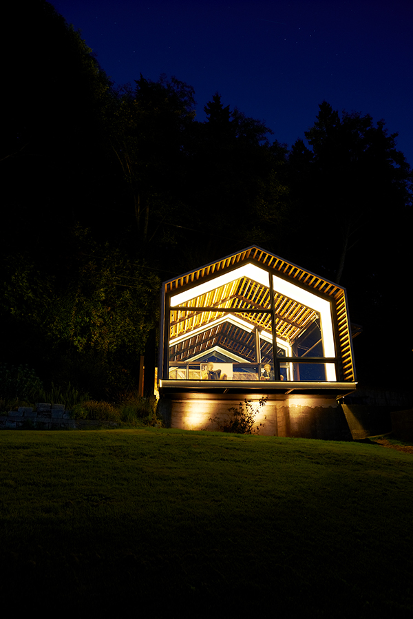 Front view of glass holida cabin created from a garage renovation by Graypants
