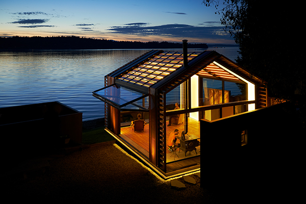 Holiday cabin on the water at sunset