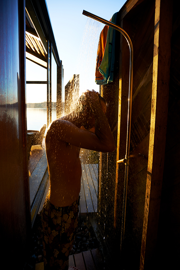 Man showering outside holiday cabin