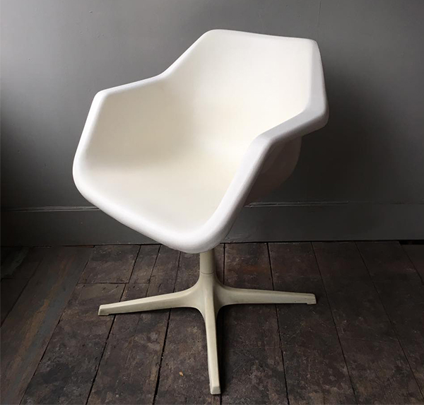Vintage white Robin Day chair
