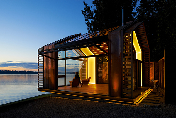 Waterfront cabin created from a garage renovation at sunset