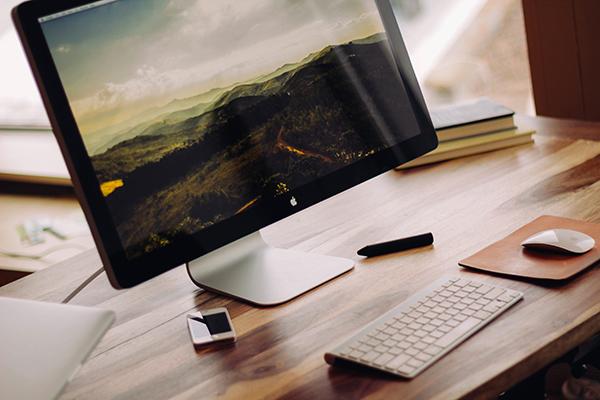 desk with desktop computer monitor