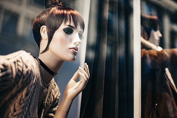 female mannequin with red hair make-up and choker necklace