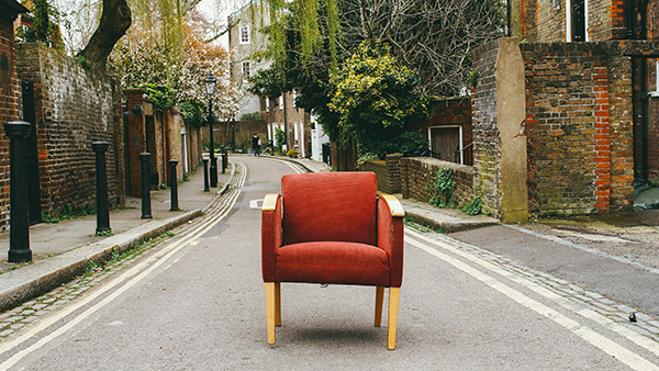 red vintage armchair on the street