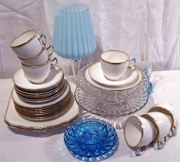 stack of vintage china and glassware