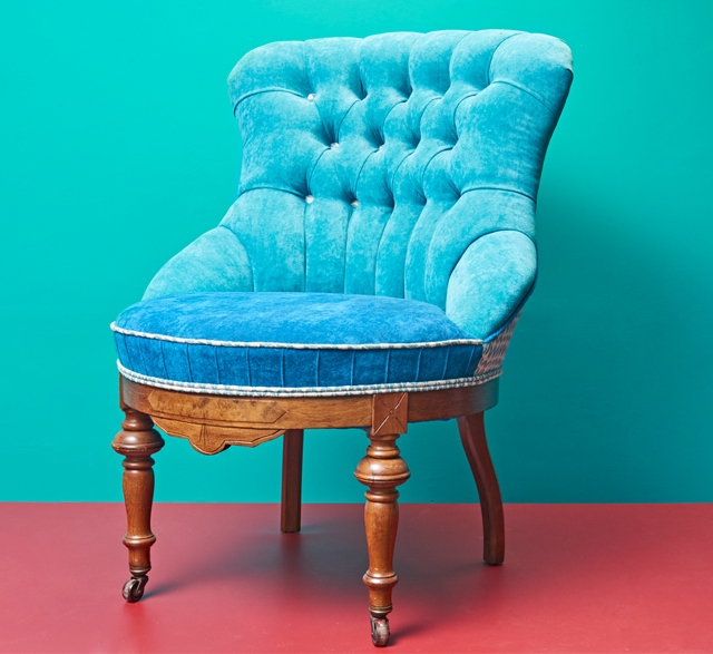 Blue upholstered button back chair