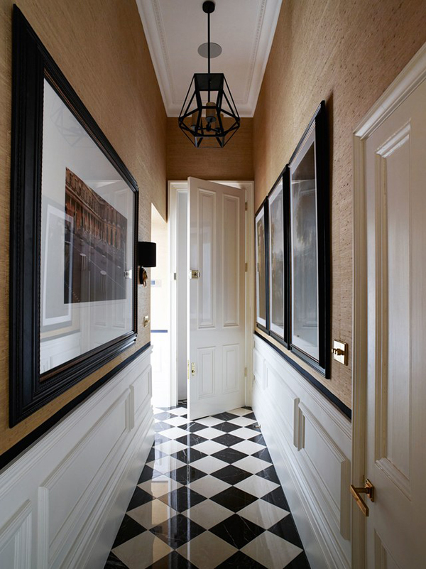 Chequerboard tiled floor in the hallway of an elegant London townhouse