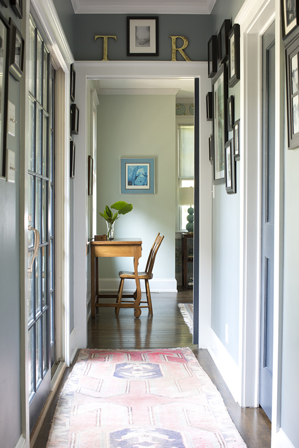 Light filled hallway with grey walls and vintage carpet