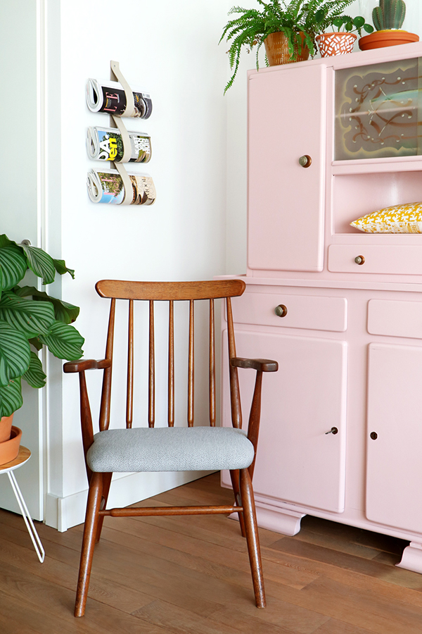 Mid-century chair and pink painted sideboard