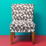 Midcentury chair upholstered in grey and yellow patterned fabric
