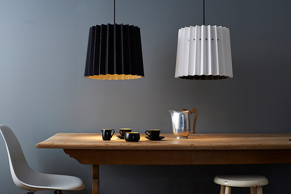 Monochrome lampshades hanging over dining table