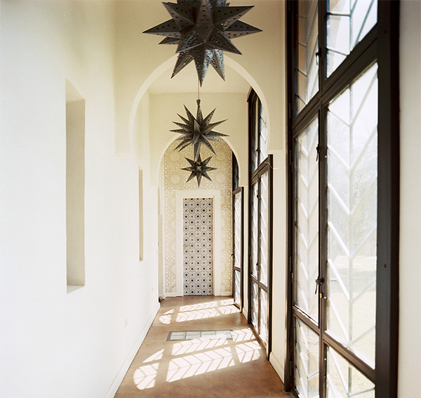 Morrocan lighting in sunlit narrow corridor